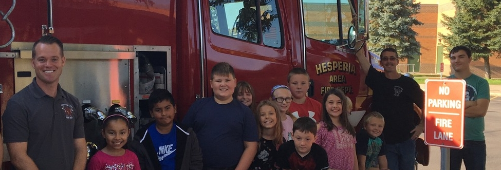 Elementary class by fire truck